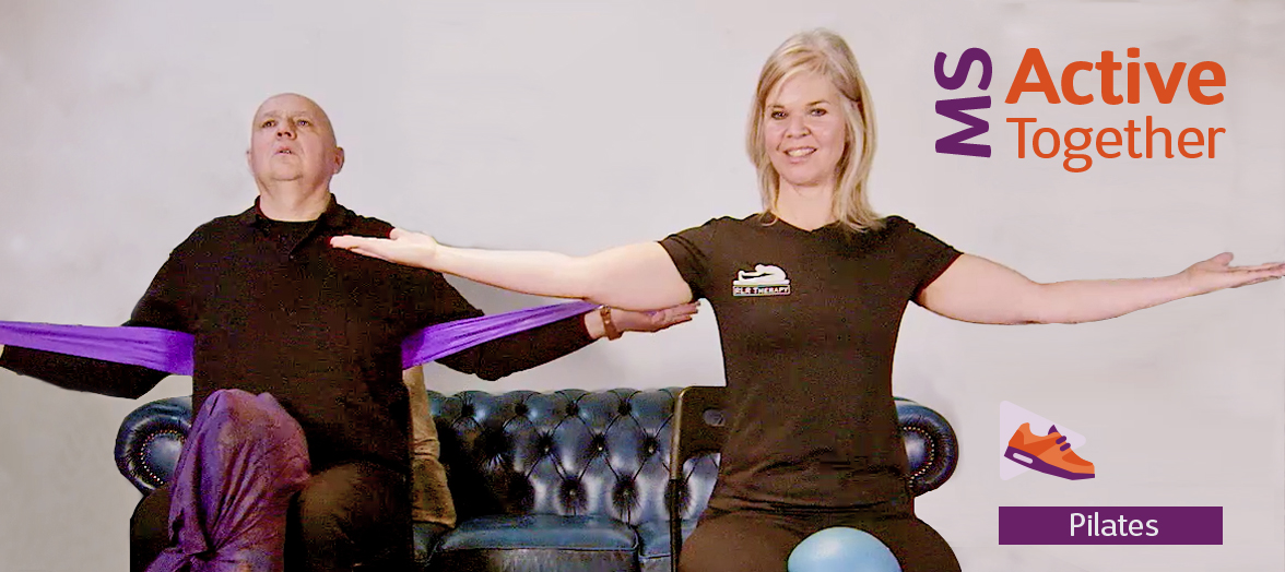 Photo shows Simon and Ruth doing seated Pilates