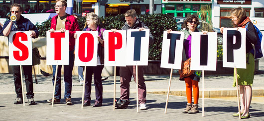 Activists holding stop TTIP signs in Bristol