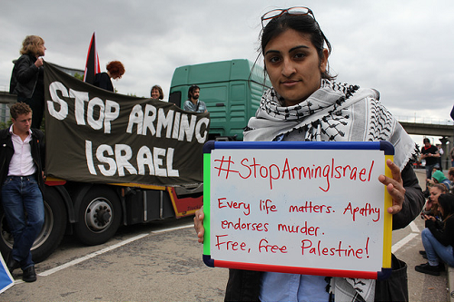 Stop Arming Israel woman white board at demo.png