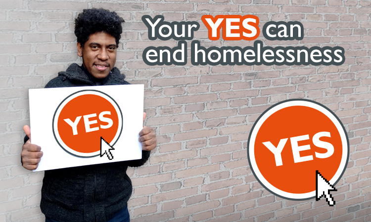 "St Mungo's client Jordan holding a yes sign, alongside the strapline ""Your yes can end homelessness"""