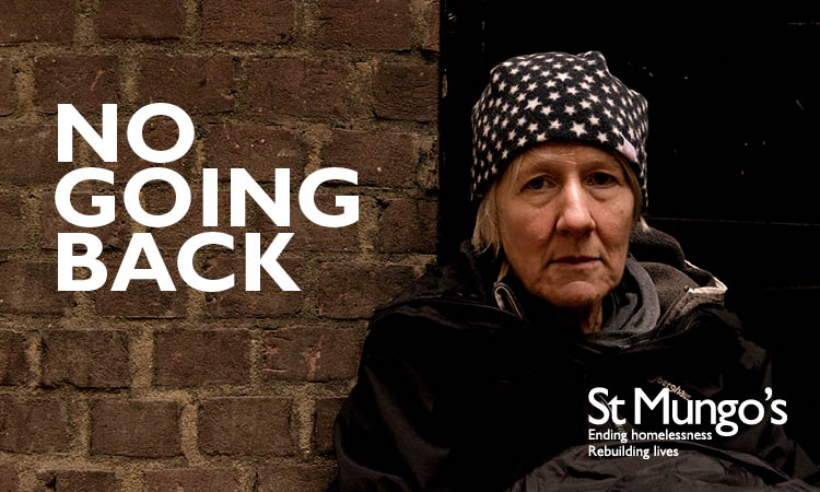 Woman sitting on the floor outside next to a brick wall looks into the camera. The words 'No Going Back' are on the image.