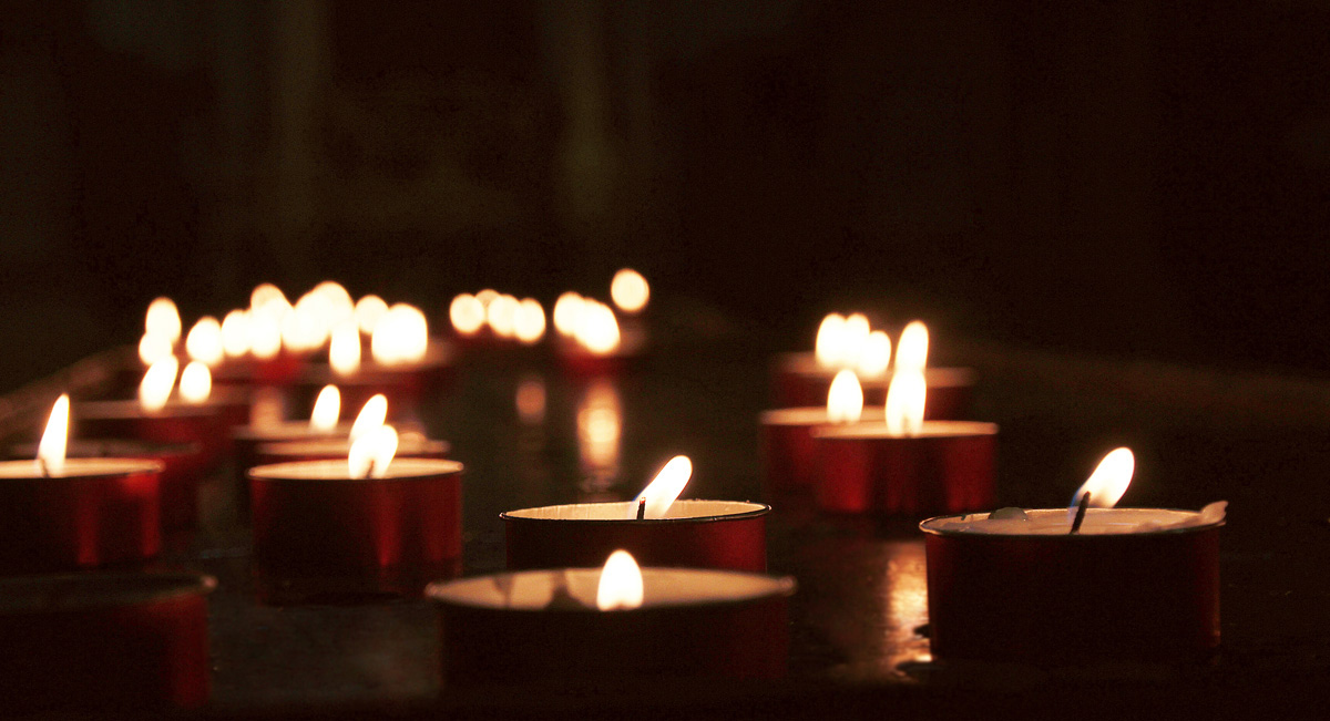 Lit tealight candles representing a vigil.