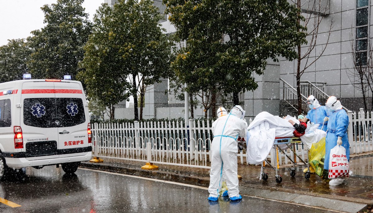 Chinese Red Cross workers street-level fighting the Coronavirus outbreak.