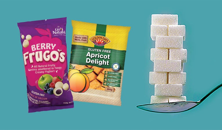 Berry Frugo's and Apricot Delight packets next to a teaspoon of sugar cubes.
