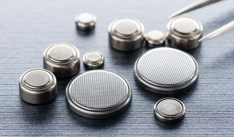Close-up of button batteries.