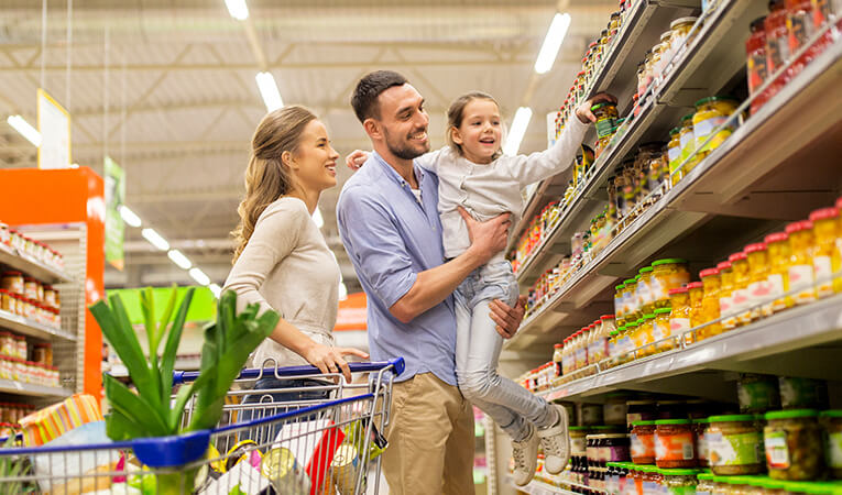 Family shopping for groceries at the supermarket.