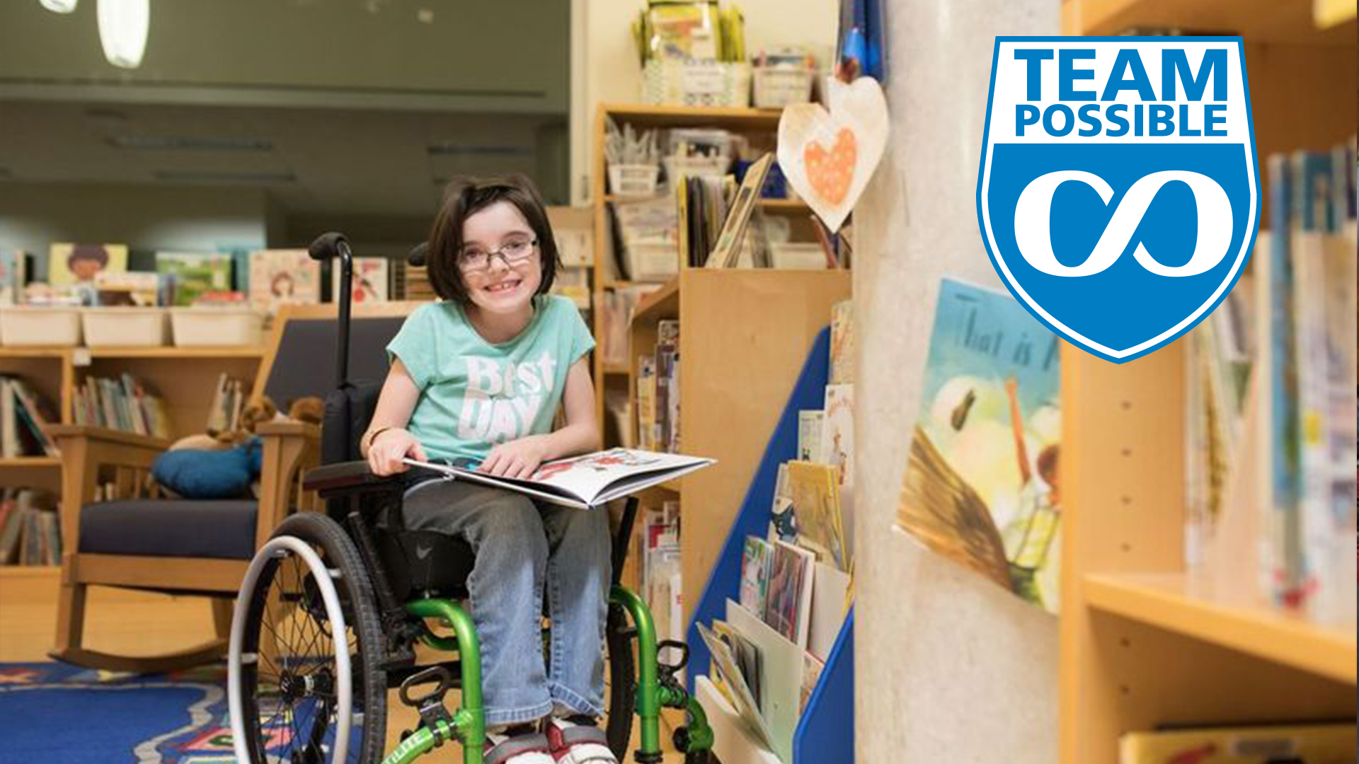 Photo of a kid on their wheelchair reading a book
